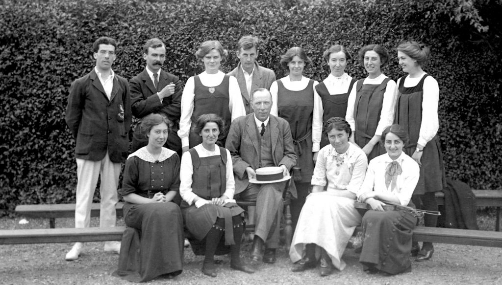 Winifred in the front row on the left taken at Stratford-upon-Avon with Cecil Sharp and Douglas Kennedy in the middle.